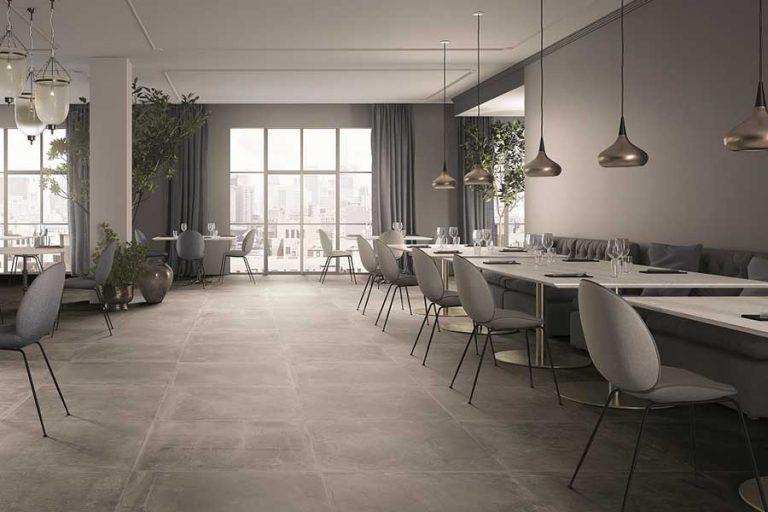 אריחי Dust Gray מעניקים מראה טבעי המשלב גסות מעודנת, בתוך חלל מסעדה מודרנית- להשיג באולם התצוגה של ויה ארקדיה